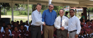 Hans Coertse (Managing Member of Anderson Engineering), Mr Basil Manual (Principal), Mr Jasson (former Vice Principal now Principal of Woodlands Primary) of Forest Hill Primary School) and Trevor Govender (Anderson Engineering)