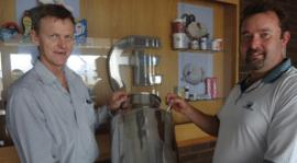 Hans Coertse handing over the urn to Peter Parry, dairy manager of Sunnyside Farm (representing Pietermaritzburg Mental Health Society)